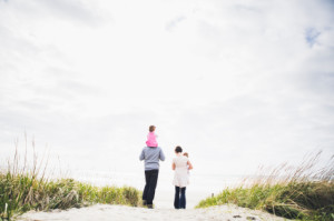 Family walking on beach Single Income pic